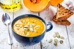 Homemade pumpkin cream soup with seeds Stock Images