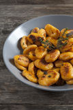 Homemade pumpkin dumplings italian orange gnocchi with thyme Stock Photos