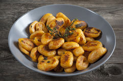 Homemade pumpkin dumplings italian orange gnocchi with thyme Royalty Free Stock Image