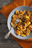 Homemade pumpkin dumplings italian orange gnocchi with thyme Stock Photo