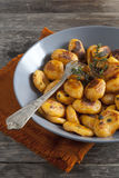 Homemade pumpkin dumplings italian orange gnocchi with thyme Stock Photography