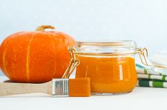 Homemade pumpkin face mask in a glass jar. DIY cosmetics and spa. royalty free stock photos