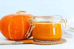 Homemade pumpkin face mask in a glass jar. DIY cosmetics and spa. Copy space. royalty free stock image