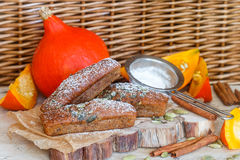Homemade pumpkin financier cake with cinnamon and cardamom. Autumn spiced cakes. A rustic style. Selective focus royalty free stock images
