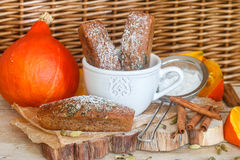 Homemade pumpkin financier cake with cinnamon and cardamom. Autumn spiced cakes. A rustic style. Selective focus stock photography