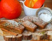 Homemade pumpkin financier cake with cinnamon and cardamom. Autumn spiced cakes Royalty Free Stock Photo