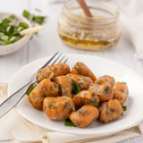 Homemade pumpkin gnocchi with sage butter stock photography