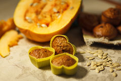 Homemade pumpkin muffins in the shape of heart Royalty Free Stock Photography