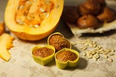 Homemade pumpkin muffins in the shape of heart Stock Photos