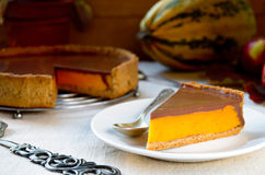 Homemade pumpkin pie with chocolate topping Royalty Free Stock Images