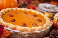 Homemade pumpkin pie on a rustic table with autumn decorations Royalty Free Stock Image