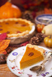 Homemade pumpkin pie on a rustic table with autumn decorations Stock Photography