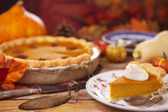 Homemade pumpkin pie on a rustic table with autumn decorations Royalty Free Stock Photography