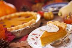 Homemade pumpkin pie on a rustic table