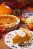 Homemade pumpkin pie on a rustic table Royalty Free Stock Photography