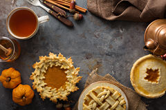 Homemade pumpkin pies decorated with fall leaves Royalty Free Stock Image