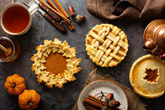 Homemade pumpkin pies decorated with fall leaves royalty free stock photography