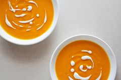 Homemade Pumpkin Soup. Couple of bowls of homemade soup with organic vegetables Stock Photography