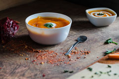 Homemade pumpkin soup with cream and parsley on a wooden background Stock Image