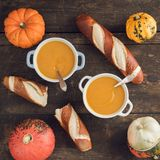 Pumpkin soup and pretzel sticks Stock Photos