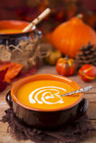 Homemade pumpkin soup on a rustic table Royalty Free Stock Photography
