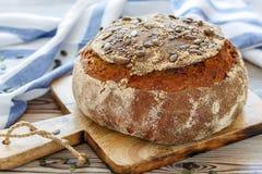 Homemade pumpkin bread. Homemade pumpkin sourdough bread on wooden kitchen table Royalty Free Stock Photos