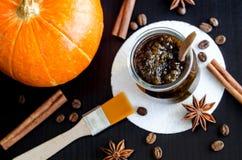 Homemade pumpkin spice facial mask/scrub made with ripe pumpkin puree, sugar and honey, cinnamon powder and ground coffee. royalty free stock image