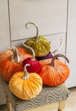 Homemade pumpkins for Halloween.Exclusive designer pumpkins for decorating the holiday of Halloween. Pumpkins made of corduroy fab Royalty Free Stock Photography