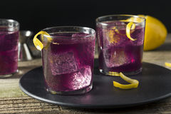 Homemade Purple Haze Cocktail. With a Lemon Garnish Stock Images