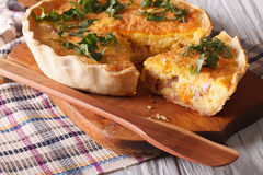 Homemade quiche Lorraine close-up on a cutting board. horizontal Royalty Free Stock Images
