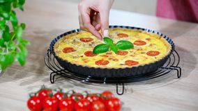 Homemade Quiche Lorraine decorated basil.  stock footage