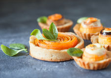 Homemade quiche tart with carrot, eggplant and cabbage roulade w. Ith soft cheese, healthy vegetarian snack on biscuit egg less dough Royalty Free Stock Photo
