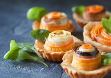 Homemade quiche tart with carrot, eggplant and cabbage roulade w. Ith soft cheese, healthy vegetarian snack on biscuit egg less dough Royalty Free Stock Image