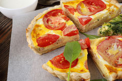 Homemade quiche with tomatoes royalty free stock photo