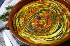 Homemade quiche vegetable pie with green courgette and carrot Royalty Free Stock Image