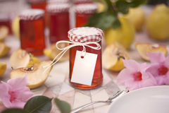 Homemade Quince jam. With a blank tag for text or logo Stock Images