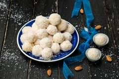 Homemade Raffaello Sweets - Coconut Balls. With condensed milk stuffed with almonds Sweets for Christmas Party stock photos