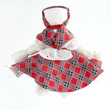 Homemade rag doll. Handmade doll from pieces of fabric on a white background royalty free stock photography