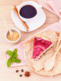 Homemade raspberry cake with cup of coffee . Stock Photography