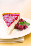 Homemade raspberry cheesecake slice Stock Photography