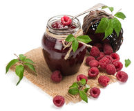 Homemade  raspberry jam in a jar and berries aside Stock Image
