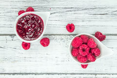 Fresh made Raspberry Jam on a rustic background. Homemade Raspberry Jam on an wooden table as detailed close-up shot; selective focus Stock Photo