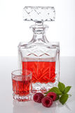 Homemade raspberry liqueur Stock Images