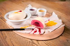 Homemade Raspberry Petit Gateau with painting brush. royalty free stock images
