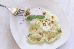 Homemade Ravioli with cheese cream sauce Stock Photos