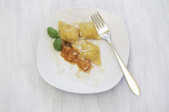 Homemade Ravioli with cheese and tomato sauce Stock Photos