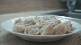 The homemade ravioli is cooked in a pan with the boiling water stock footage