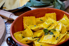 Homemade ravioli pasta with sage butter sauce , italian food Royalty Free Stock Photos