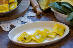 Homemade ravioli pasta with sage butter sauce , italian food Stock Photography