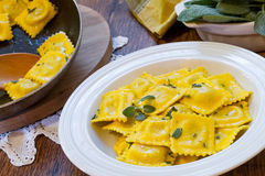 Homemade ravioli pasta with sage butter sauce , italian food Stock Photo